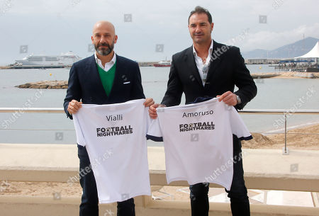 "Stock Image of Italian football manager and former footballer Gainluca Vialli, left, and retired Italian footballer Lorenzo Amoruso pose for photographers during the MIPTV, International Television Programme Market, in Cannes, southern France. They present new tv reality format ""Football Nightmares"