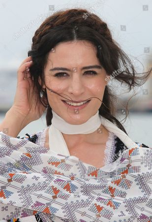 """Stock Image of Turkish actress Belcim Bilgin poses for photographers during the MIPTV, International Television Programme Market, in Cannes, southern France. She presents tv series """"Intersection"""