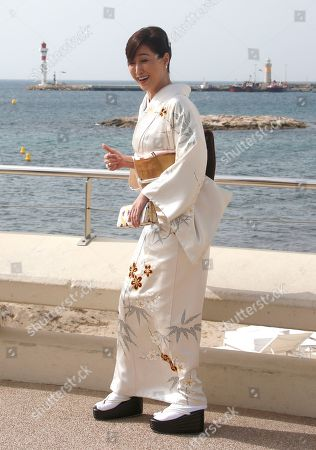 "Stock Photo of Japanese actress Reiko Takashima poses for photographers during the MIPTV, International Television Programme Market, in Cannes, southern France. She presents tv series ""Moribito: guardian of the spirit"