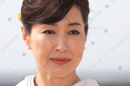 "Stock Image of Japanese actress Reiko Takashima poses for photographers during the MIPTV, International Television Programme Market, in Cannes, southern France. She presents tv series ""Moribito: guardian of the spirit"