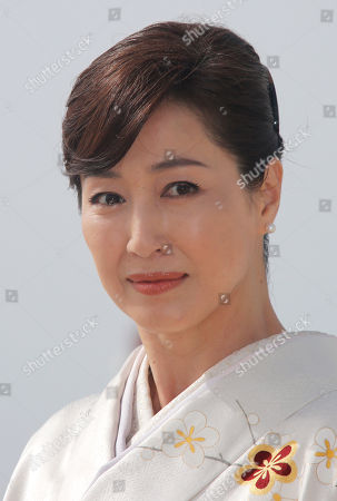 "Japanese actress Reiko Takashima poses for photographers during the MIPTV, International Television Programme Market, in Cannes, southern France. She presents tv series ""Moribito: guardian of the spirit"