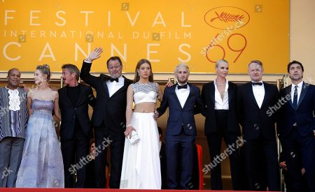 Actors Zubin Cooper, Dylan Frances Penn, director Sean Penn, Jean Reno, Adele Exarchopoulos, unidentified man, Charlize Theron, Jared Harris and Javier Bardem, from left, pose for photographers upon arrival at the screening of the film The Last Face at the 69th international film festival, Cannes, southern France