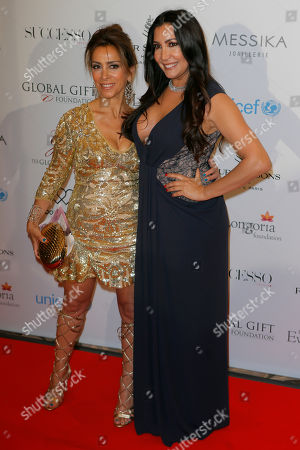 Stock Picture of Karen Ruimy, left, and Maria Bravo pose during a photo call for the Global Gift Gala at Four Seasons Hotel George V in Paris