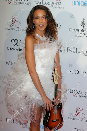Melissa NKonda poses during a photo call for the Global Gift Gala at Four Seasons Hotel George V in Paris