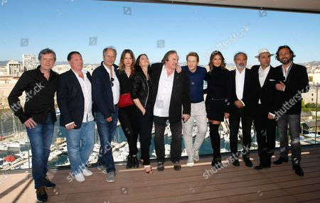 "The team of the serie ""Marseille"" left to right, Thomas Gilou Director, Florent Siri showrunner, visual creator and director, French actor Hippolyte Girardot, French actress Stephane Caillard, French actress Geraldine Pailhas, French actor Gerard Depardieu, French actor Benoit Magimel, French actress Nadia Fares, Dan Franck creator and writer, Pascal Breton Federation Entertainment, French actor Jean-Rene Privat, pose during a photocall, in Marseille, southern France, . ""Marseille"" is the first TV series produced by Netflix in France"