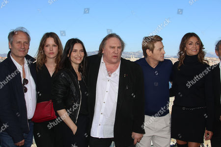 "Geraldine Pailhas, Hippolyte Girardot, Stephane Caillard, Gerard Depardieu, Benoit Magimel, Nadia Fares The team of the serie ""Marseille"" left to right, French actor Hippolyte Girardot, French actress Stephane Caillard, French actress Geraldine Pailhas, French actor Gerard Depardieu, French actor Benoit Magimel, French actress Nadia Fares, pose at the premiere of the serie ""Marseille"", in the Pharo Palace, in Marseille, southern France, . Marseille is the first TV series produced by Netflix in France"