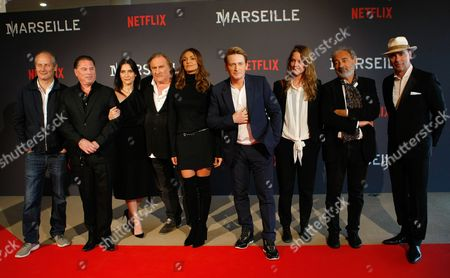 """Stock Picture of Geraldine Pailhas, Florent Siri, Hippolyte Girardot, Stephane Caillard, Gerard Depardieu, Benoit Magimel, Nadia Fares, Dan Franck, Pascal Breton The team of the series """"Marseille"""" left to right, French actor Hippolyte Girardot, Florent Siri showrunner, visual creator and director, French actress Geraldine Pailhas, French actor Gerard Depardieu, French actress Nadia Fares, French actor Benoit Magimel, French actress Stephane Caillard, Dan Franck creator and writer, Pascal Breton President of Federation Entertainment, pose at the premiere of the serie """"Marseille"""", in the Pharo Palace, in Marseille, southern France, . Marseille is the first TV series produced by Netflix in France"""