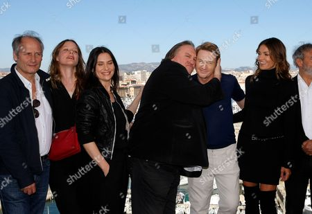 "Geraldine Pailhas, Hippolyte Girardot, Stephane Caillard, Gerard Depardieu, Benoit Magimel, Nadia Fares, Dan Franck, Pascal Breton The team of the serie ""Marseille"" left to right, French actor Hippolyte Girardot, French actress Stephane Caillard, French actress Geraldine Pailhas, French actor Gerard Depardieu, French actor Benoit Magimel, French actress Nadia Fares, pose during a photocall, in Marseille, southern France, . ""Marseille"" is the first TV series produced by Netflix in France"