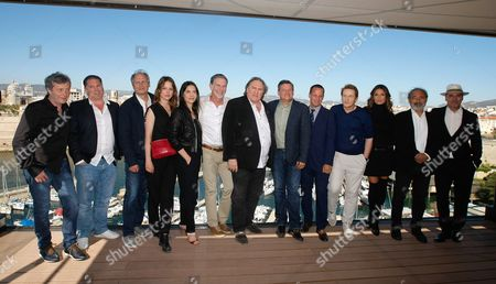 "Reed Hastings, Ted Sarandos, Geraldine Pailhas, Gerard The team of the serie ""Marseille"" left to right, Thomas Gilou, Florent Siri, Hippolyte Girardot, Stephane Caillard, Gerard Depardieu, Erick Barmack, Benoit Magimel, Nadia Fares, Dan Franck, Pascal Breton The team of the serie ""Marseille"" from left, Director Thomas Gilou, Florent Siri showrunner, visual creator and director, French actor Hippolyte Girardot, French actress Stephane Caillard, French actress Geraldine Pailhas, Reed Hastings, CEO of Netflix, a global provider of streaming movies and TV series, French actor Gerard Depardieu, Ted Sarandos Chief Content Officer of Netflix, Erick Barmack Netflix Vice President International Originals, French actor Benoit Magimel, French actress Nadia Fares, Dan Franck creator and writer, Pascal Breton Federation Entertainment, pose during a photocall, in Marseille, southern France, . Marseille is the first TV series produced by Netflix in France"