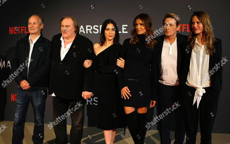 "The team of the serie ""Marseille"" left to right, French actor Hippolyte Girardot, French actor Gerard Depardieu, French actress Geraldine Pailhas, French actress Nadia Fares, French actor Benoit Magimel, French actress Stephane Caillard, pose at the premiere of the serie ""Marseille"", in Marseille, southern France, . ""Marseille"" is the first TV series produced by Netflix in France"