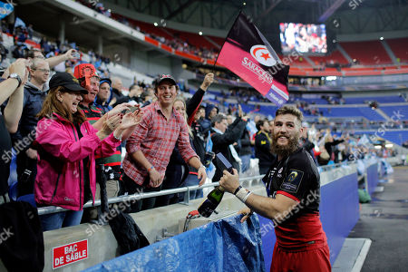 Saracens' Will Fraser celebrates with fans after winning the European Rugby Champions Cup final match against Racing 92 in Decines, near Lyon, central France