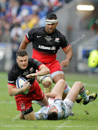 Saracens' Will Fraser, left, is tackled by Racing 92's Remi Tales during their European Rugby Champions Cup final match in Decines, near Lyon, central France