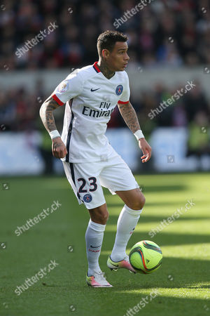 Paris Saint Germain's defender Gregory Van Der Wiel of Netherlands dribbles the ball during his French League One soccer match against Guingamp, in Guingamp, western France