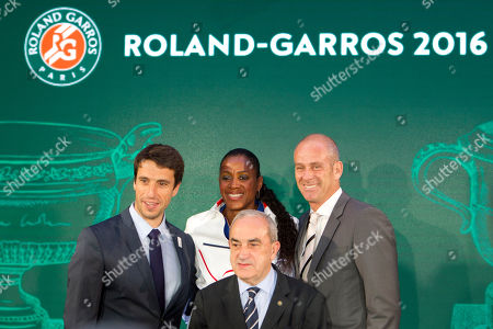 From the left, French Olympic champions Tony Estanguet and Marie-Jose Perec, Guy Forget, director of Roland Garros, pose with head of the French Tennis Federation Jean Gachassin before the draw of the French Open tennis tournament at the Roland Garros stadium, in Paris. The French Open starts Sunday May 22
