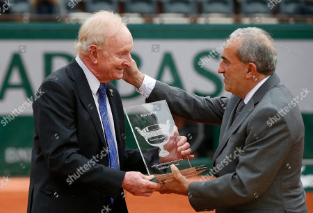 Former Australian tennis champion Rod Laver, left, receives an award from Jean Gachassin, head of the French tennis Federation, during the French Open tennis tournament at the Roland Garros stadium in Paris, France
