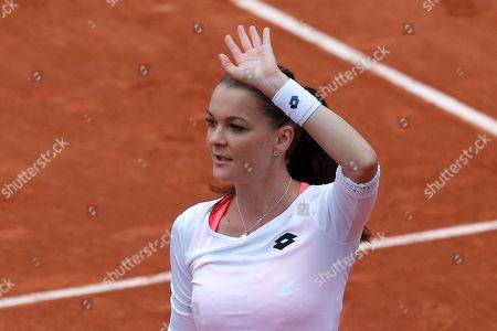 Poland's Agnieszka Radwanska waves after defeating Serbia's Bojana Jovanovski during their first round match of the French Tennis Open at the Roland Garros stadium in Paris. Radwanska won 6-0, 6-2