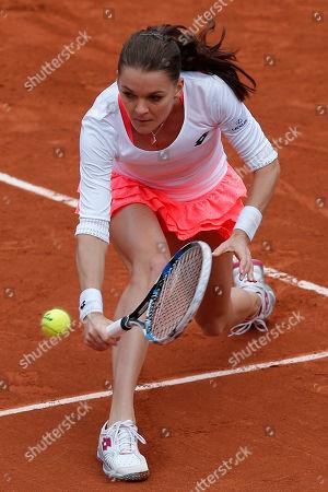 Poland's Agnieszka Radwanska returns the ball to Serbia's Bojana Jovanovski during their first round match of the French Tennis Open at the Roland Garros stadium in Paris. Radwanska won 6-0, 6-2
