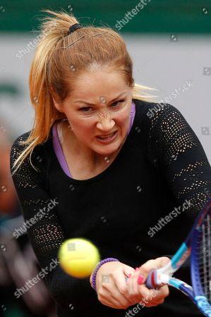 Serbia's Bojana Jovanovski backhands to Poland's Agnieszka Radwanska during their first round match of the French Tennis Open at the Roland Garros stadium in Paris