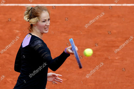Serbia's Bojana Jovanovski returns the ball to Poland's Agnieszka Radwanska during their first round match of the French Tennis Open at the Roland Garros stadium in Paris. Radwanska won 6-0, 6-2