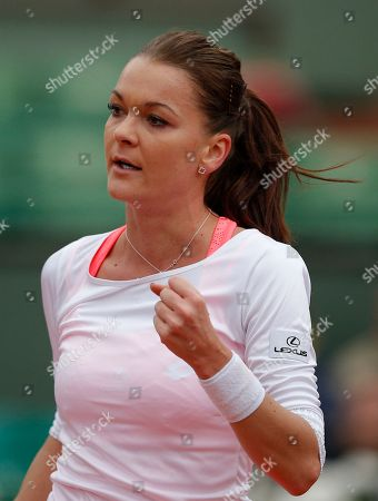 Poland's Agnieszka Radwanska clenches her fist as she plays Serbia's Bojana Jovanovski during their first round match of the French Tennis Open at the Roland Garros stadium in Paris