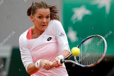 Poland's Agnieszka Radwanska returns the ball to Serbia's Bojana Jovanovski during their first round match of the French Tennis Open at the Roland Garros stadium in Paris