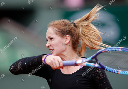 Serbia's Bojana Jovanovski returns the ball to Poland's Agnieszka Radwanska during their first round match of the French Tennis Open at the Roland Garros stadium in Paris
