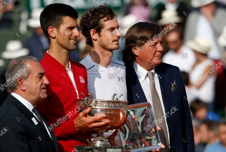 Former Italian tennis ace Adriano Panatta, right, poses Serbia's Novak Djokovic, second left, who won the final of the French Open tennis tournament, and Britain's Andy Murray, left, at the Roland Garros stadium in Paris, France, . At left is Jean Gachassin, head of the French tennis federation