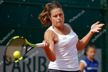 Italy's Karin Knapp returns in the third round match of the French Open tennis tournament against Kazakhstan's Yulia Putintseva at the Roland Garros stadium in Paris, France