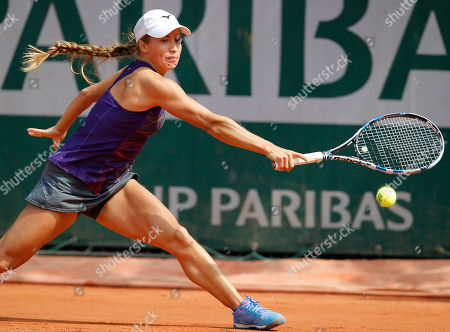 Kazakhstan's Yulia Putintseva returns in the third round match of the French Open tennis tournament against Italy's Karin Knapp at the Roland Garros stadium in Paris, France