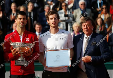 Former Italian tennis ace Adriano Panatta, right, poses with Serbia's Novak Djokovic, left, who won the final of the French Open tennis tournament against Britain's Andy Murray, center, during the cup ceremony at the Roland Garros stadium in Paris, France