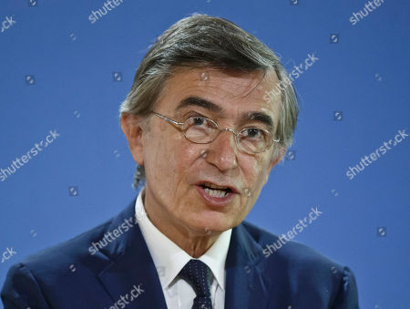French diplomat competing to be the world's top health official, Philippe Douste-Blazy, addresses the media during a press conference held in Paris, France, . Philippe Douste-Blazy, says a global tax can help fill the World Health Organization's coffers