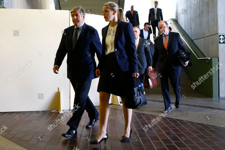 Stock Image of Former Deutsche Bank CEO Josef Ackermann, left, and his lawyers arrive at a court in Munich, Germany, where he and former top managers of Deutsche Bank face trial on accusations of giving false statements in the proceedings of the bankruptcy of German Kirch media group