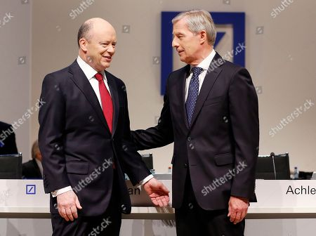 Co-CEOs of Deutsche Bank John Cryan, left, and Juergen Fitschen talk ahead of the bank's annual shareholders meeting in Frankfurt, Germany