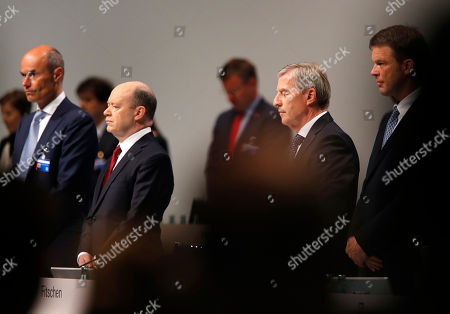 Co-CEOs of Deutsche Bank John Cryan, 2nd left, and Juergen Fitschen, 2nd right, observe a minute of silence during the bank's annual shareholders meeting in Frankfurt, Germany