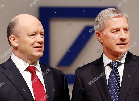 Co-CEOs of Deutsche Bank John Cryan, left, and Juergen Fitschen stand together ahead of the bank's annual shareholders meeting in Frankfurt, Germany