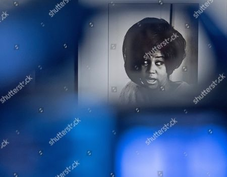 The photo of Aretha Franklin by Linda McCartney is seen behind a camera during the press preview at the exhibition 'Sixties' by Linda McCartney in the Avant-garde House of Art in Apolda, Germany, . The exhibition presents the works of the photographer Linda McCartney and offers intimate insight into the private life of the McCartneys, the Beatles and other artists. The exhibition starts on April 10, 2016 and lasts until June 19, 2016