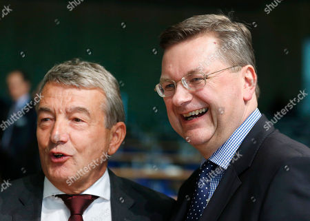 New elected President of German Soccer Federation Reinhard Grindel, right, poses with his predecessor Wolfgang Niersbach after a meeting of the German Football Federation DFB in Frankfurt, Germany