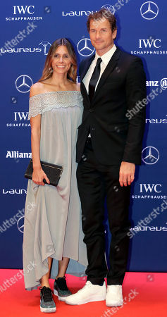 Jens Lehmann, right, and his wife Conny Lehmann, left, pose for photos as they arrive for the Laureus World Sports Awards in Berlin, Germany
