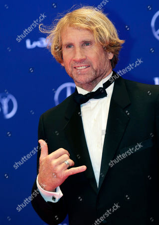 Robby Naish poses for photos as he arrives for the Laureus World Sports Awards in Berlin, Germany