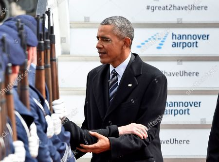 U.S. President Barack Obama, right, hugs Kimberly, the wife of John B. Emerson, US ambassador to Germany, upon his arrival at the airport in Hannover, northern Germany, . Obama is on a two-day official visit to Germany