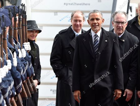John B. Emerson, US ambassador to Germany, center, and his wife Kimberly, left, welcome U.S. President Barack Obama upon his arrival at the airport in Hannover, northern Germany, . Obama is on a two-day official visit to Germany