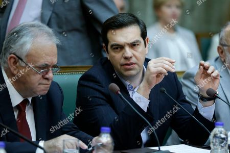Alexis Tsipras, Giannis Dragasakis Greece's Prime Minister Alexis Tsipras, right, speaks with Deputy Prime Minister Giannis Dragasakis during his government cabinet meeting in Athens, . European finance ministers on Monday debated for the first time measures to ease Greece's massive debt burden amid concern the International Monetary Fund might withdraw from the bailout talks
