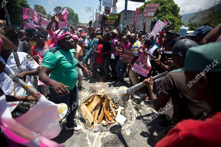 Supporters of presidential candidate Jovenel Moise, from the PHTK political party, perform a voodoo ceremony before the start of a protest to demand the second round presidential election in Port-au-Prince, Haiti, . Haiti had been scheduled to hold a presidential and legislative second runoff election on Jan. 24, but the now-splintered provisional electoral council canceled it for a second time amid protests and suspicion that the first round was marred by widespread fraud favoring Moise, the chosen candidate of former President Michel Martelly