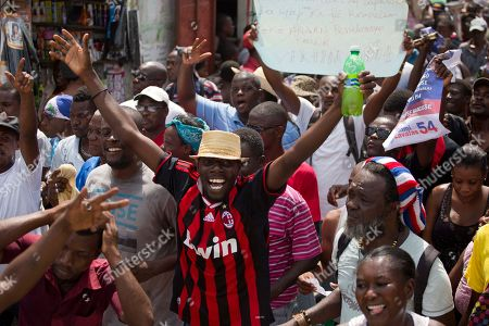 Supporters of former presidential candidate Maryse Narcisse from Fanmi Lavalas political party march to the parliament building in Port-au-Prince, Haiti, . Haiti's provisional President Jocelerme Privert provisional administration recently appointed a commission to verify contested elections held last year that many suspect were tainted by rampant dirty tricks benefiting Tet Kale, the party of previous President Michel Martelly