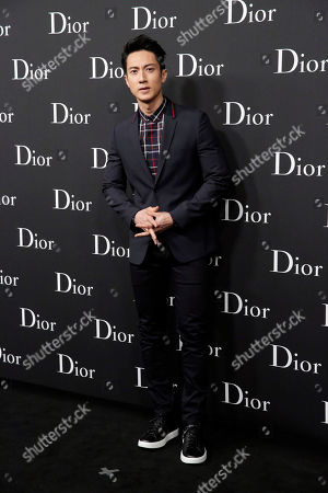 Wu Chun Brunei-born Chinese actor Wu Chun poses for photographers as he attends the Dior Homme 2016-2017 Winter collection fashion show in Hong Kong
