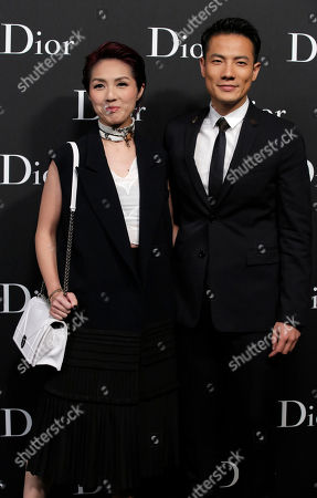 Miriam Yeung, Real Ting Hong Kong actress-singer Miriam Yeung, left, and her husband Real Ting pose for photographers as they attend the Dior Homme 2016-2017 Winter collection fashion show in Hong Kong