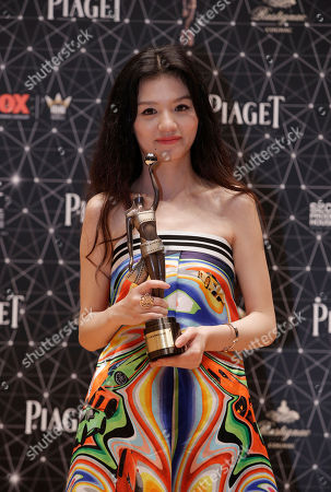 """Jessie Li Chinese actress Jessie Li poses after winning the Best Actress award for her movie """"Port of Call"""" during the Hong Kong Film Awards in Hong Kong"""