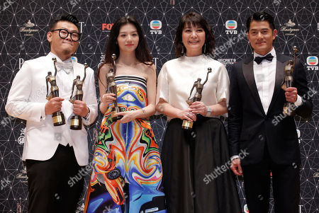 """Michael Ning, Jessie Li, Elaine Jin, Aaron Kwok From left, Hong Kong actor Michael Ning, Chinese actress Jessie Li, Taiwanese actress Elaine Jin and Hong Kong actor Aaron Kwok pose after winning the Best Supporting Actor and New Performer, the Best Actress, the Best Supporting actress and Best Actor awards for their movie """"Port of Call"""" during the Hong Kong Film Awards in Hong Kong"""