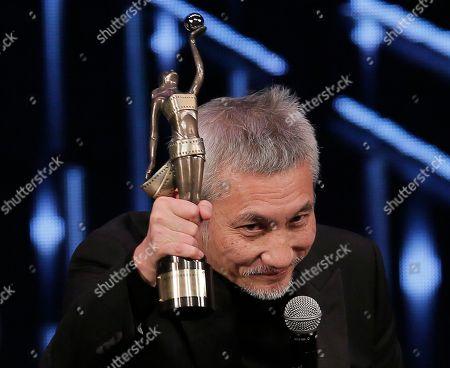Tsui Hark Hong Kong director Tsui Hark raises his Best Director award for his movie ' The Taking Of Tiger Mountain ' at the 35th Hong Kong Film Awards in Hong Kong