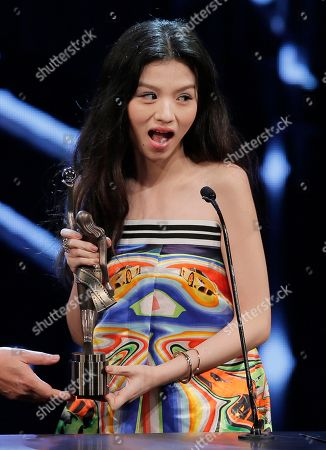 """Stock Photo of Jessie Li Chinese actress Jessie Li reacts after winning the Best Actress award for her role in the movie """"Port Of Call"""" at the 35th Hong Kong Film Awards in Hong Kong"""